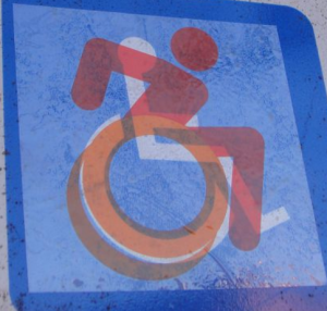 Accessible Icon Project's sticker laid over the traditional ISA logo
